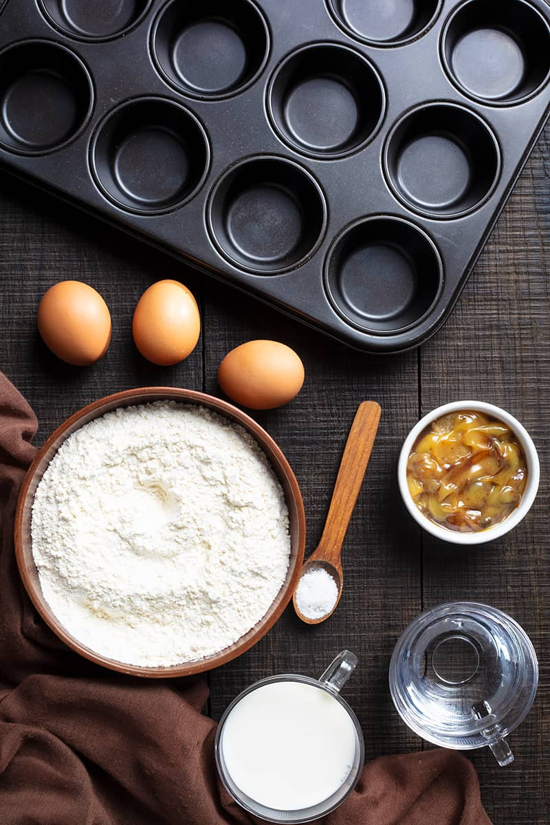 muffin tin and ingredients for Traditional Yorkshire Pudding