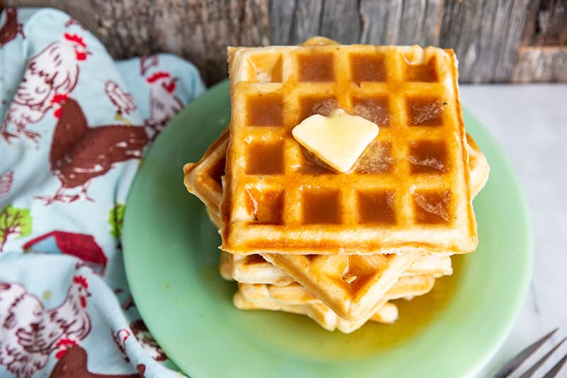 Brown Sugar Syrup on a stack of waffle with butter in a green plate
