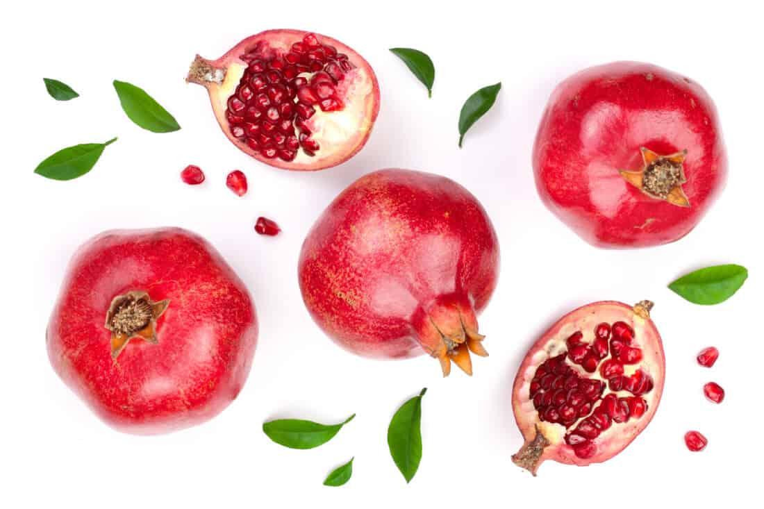 whole and sliced pomegranate fruits