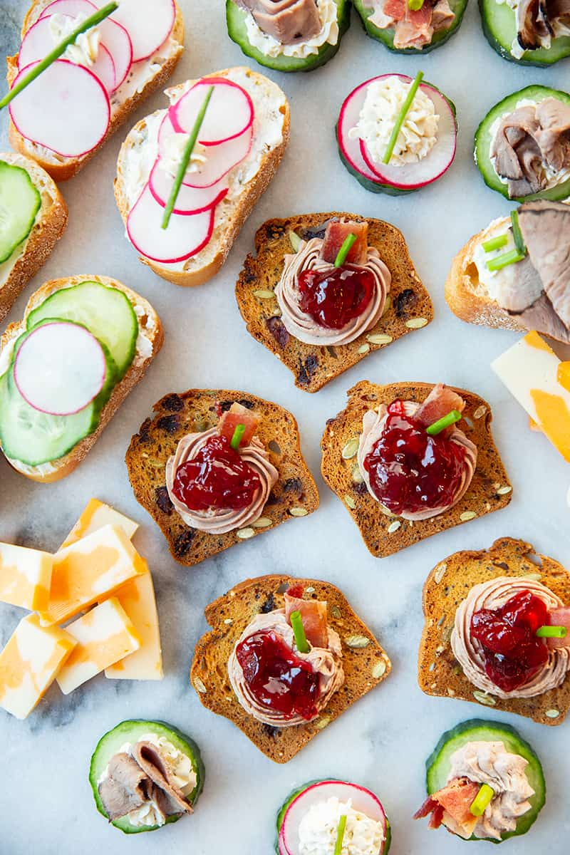 Assorted canapés garnish with chopped chives