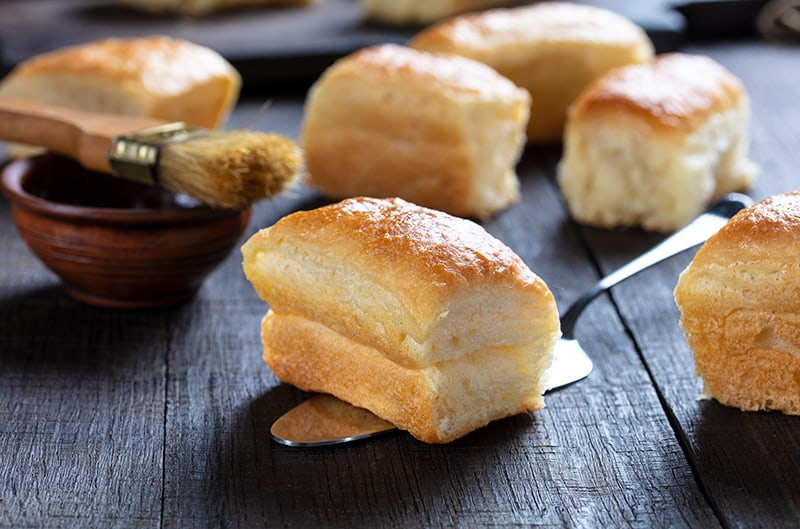 soft buttery delicious Parker House Rolls on a wooden background