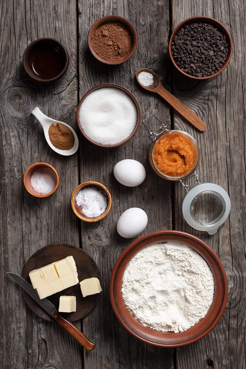 ingredients for pumpkin muffins on a large wooden board