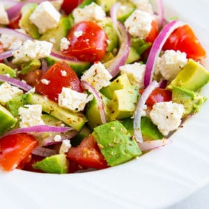 close up of avocado salad in white bowl