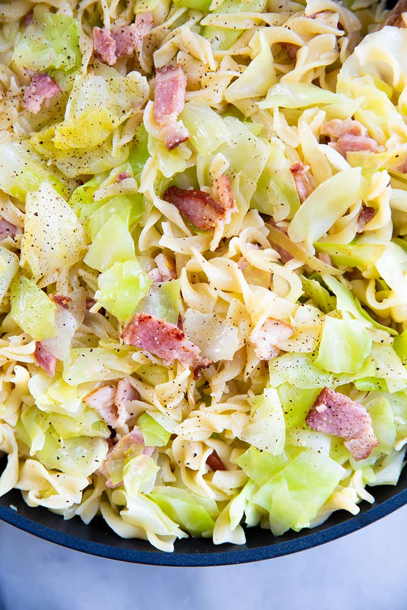 close up fried cabbage and noodles with black pepper