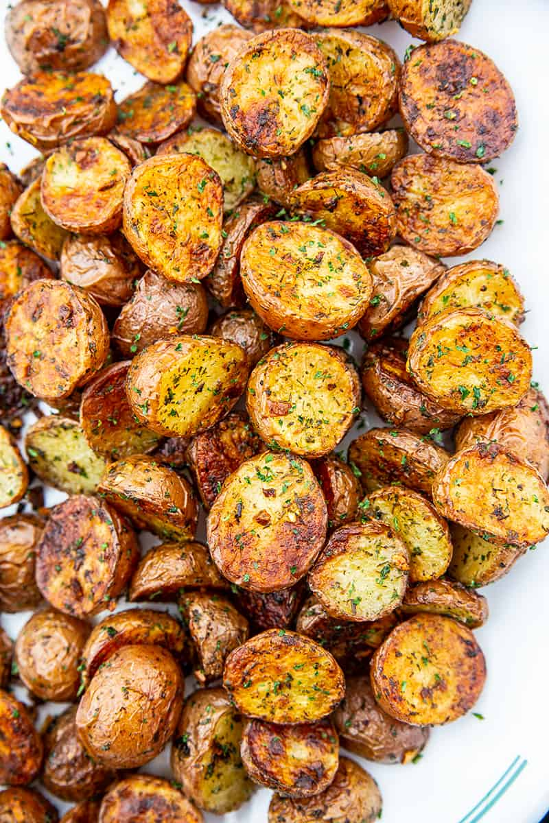 roasted red potatoes on a white serving dish
