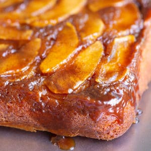 apple upside down cake with caramel dripping down the corner