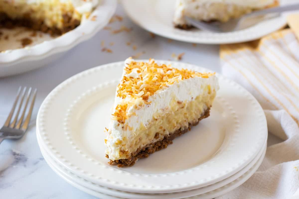Coconut Cream Pie slice on a white plate