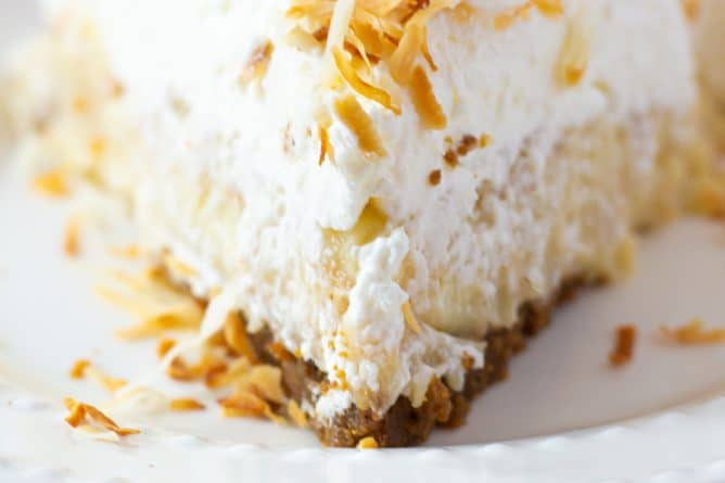 close up slice of coconut cream pie