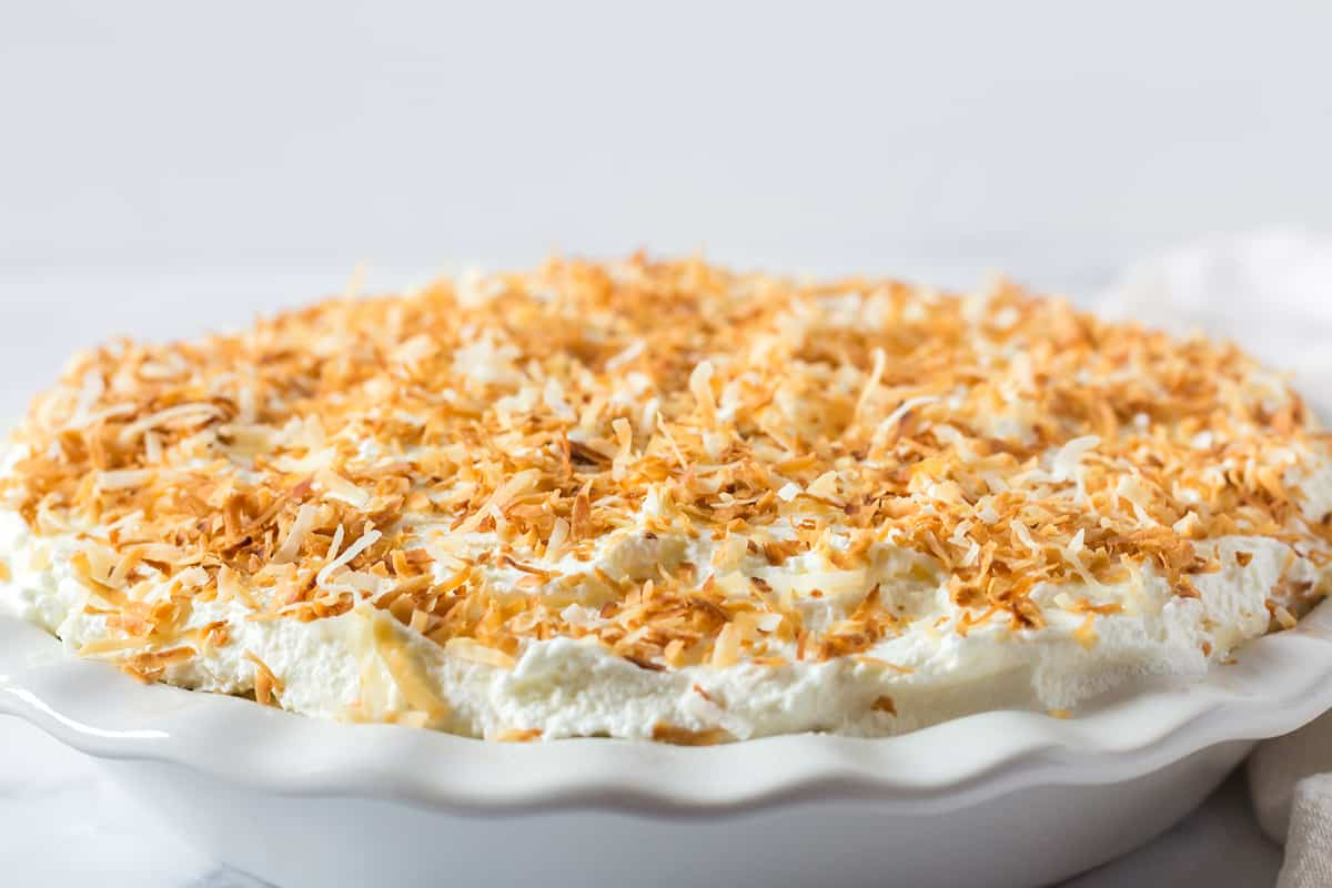 coconut cream pie in a white pie plate