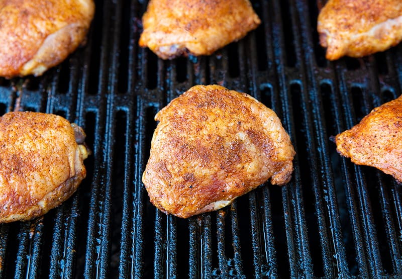 6 grilled chicken thighs on the barbecue