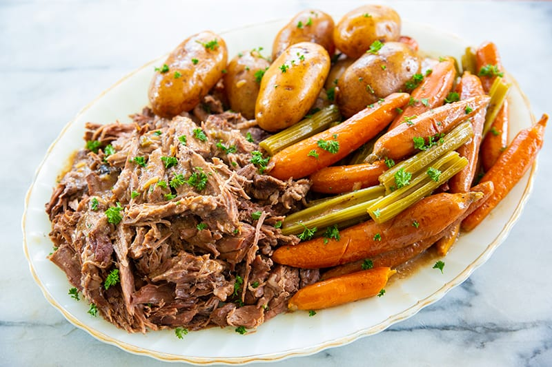 pot roast on a white plate with vegetables