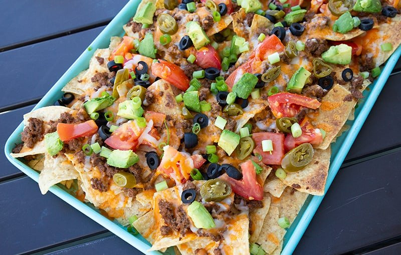 Taco Sheet Pan Nachos on a turquoise cookie sheet