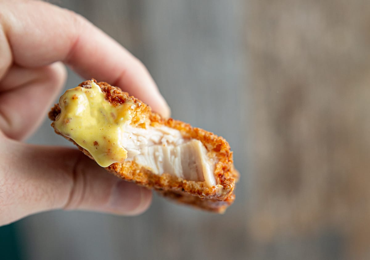 the inside of a properly of cooked chicken strip