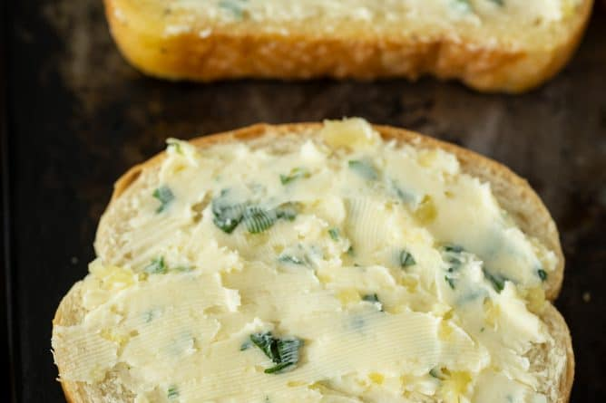 two pieces Texas toast with garlic butter spread