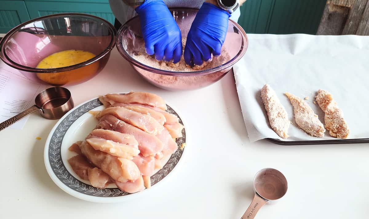 preparing chicken strips