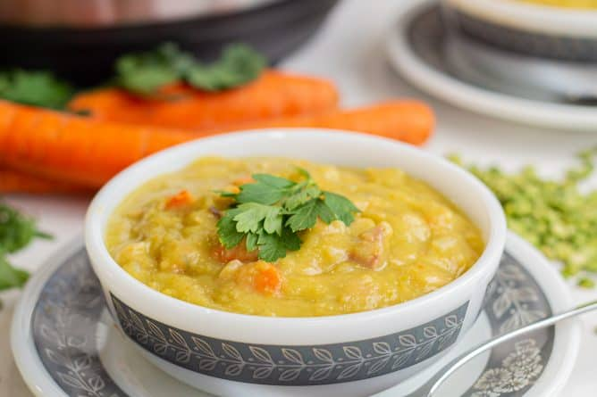split pea soup in a white bowl with an Instant Pot in the background