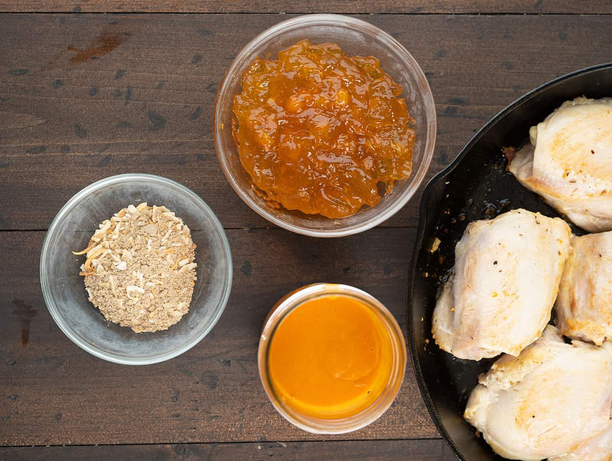 Apricot Chicken ingredients on a wooden board