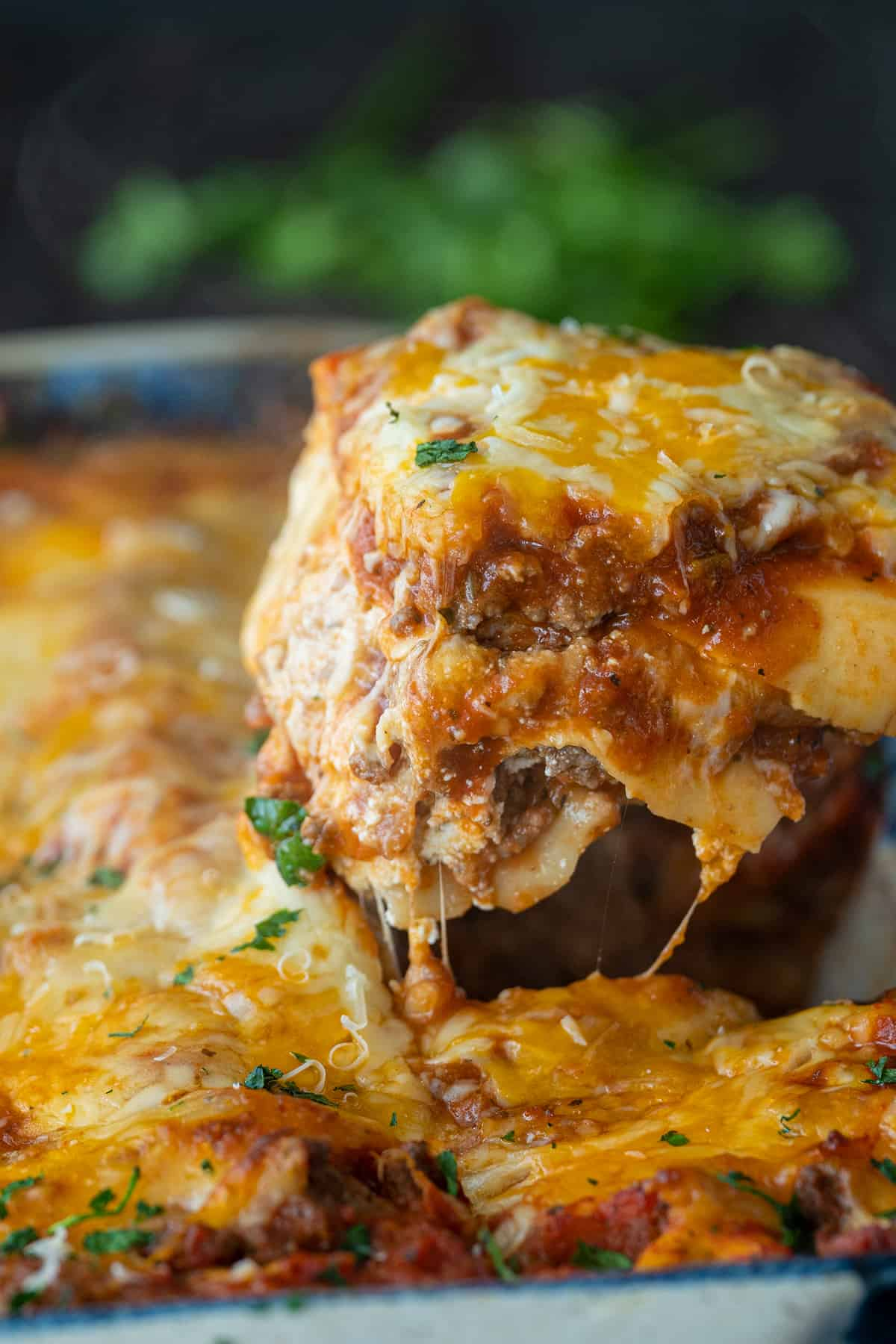 Beef Lasagna being lifted from a pan