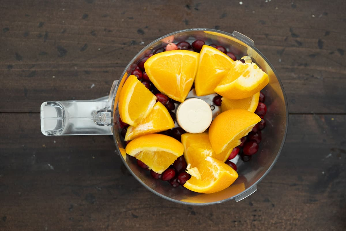 oranges and cranberries in a food processor