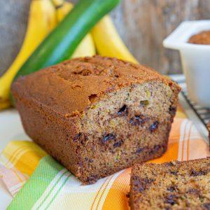 Sliced Zucchini Banana Bread, Bananas and Zucchini on background