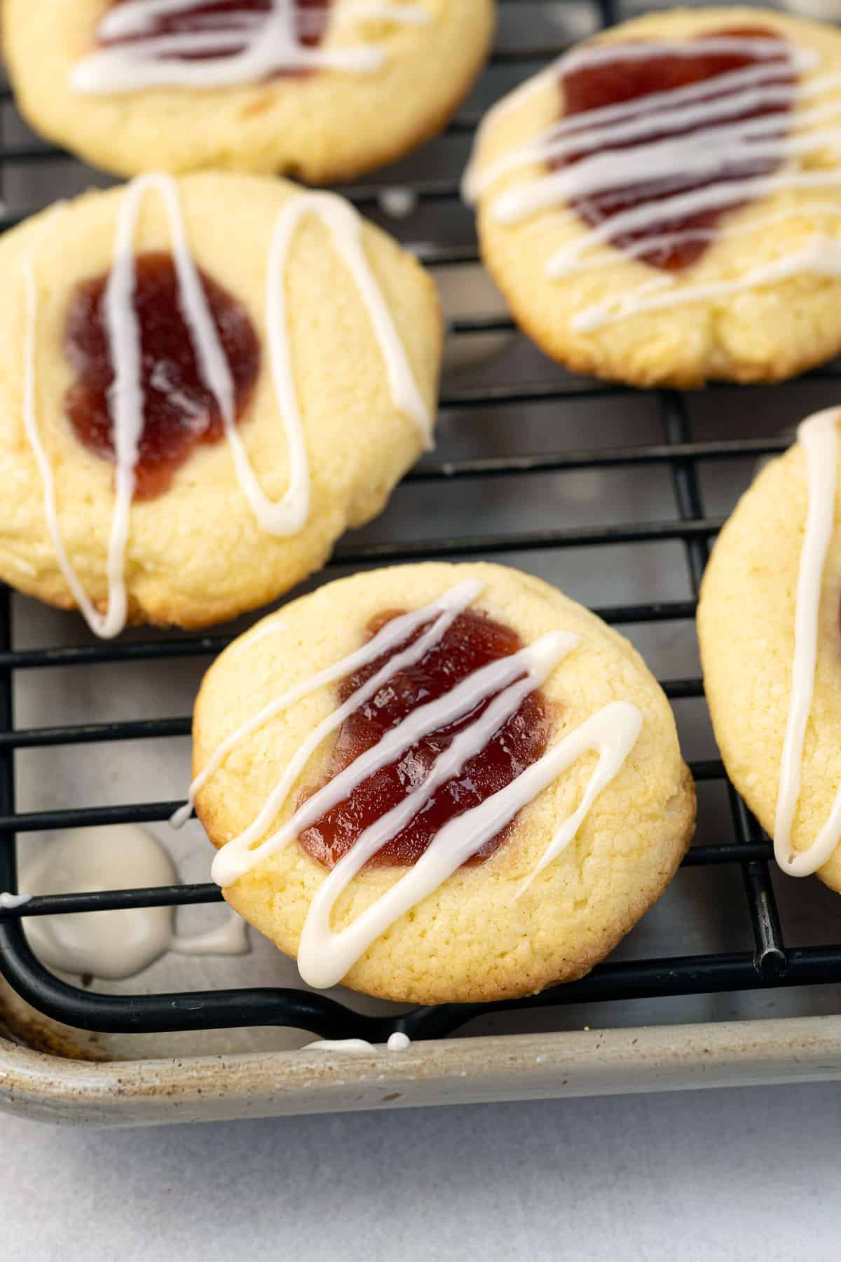 Close-up of jam filled cookies drizzled with icing