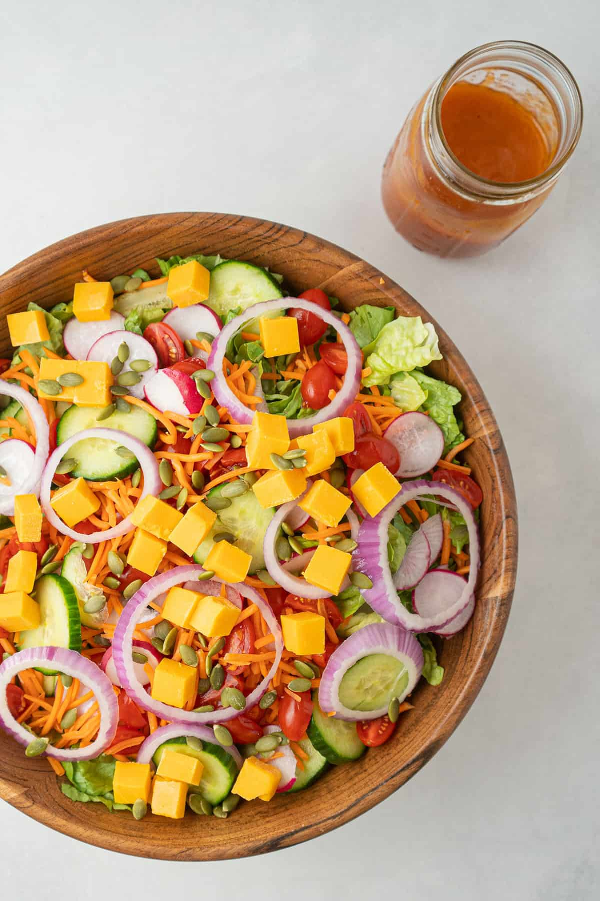 Tossed Salad in a wooden bowl with French dressing