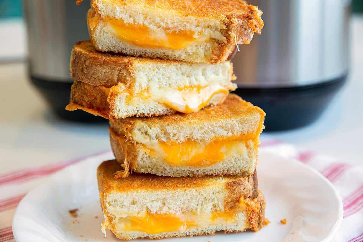 Air Fryer Grilled Cheese stacked on a white plate