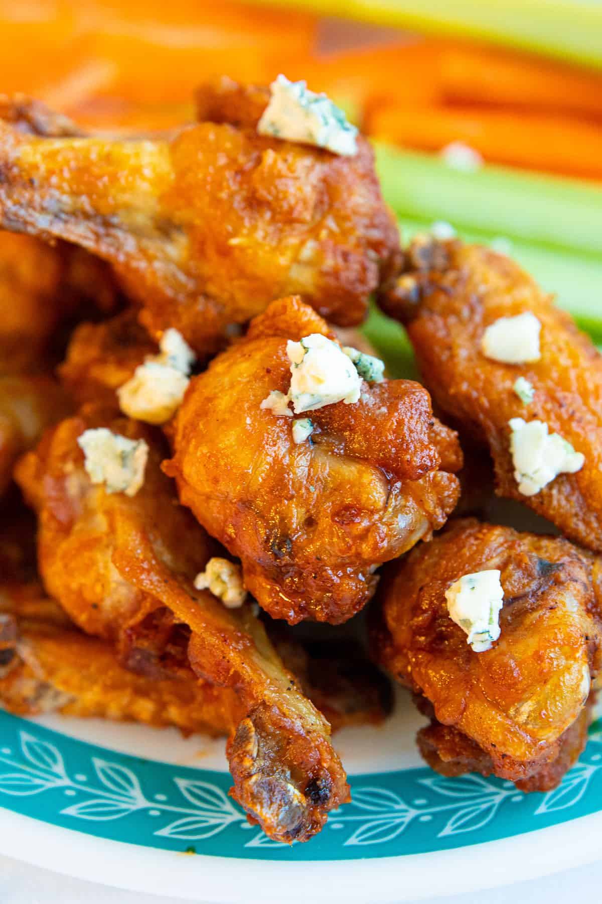 Buffalo wings covered in blue cheese crumbles
