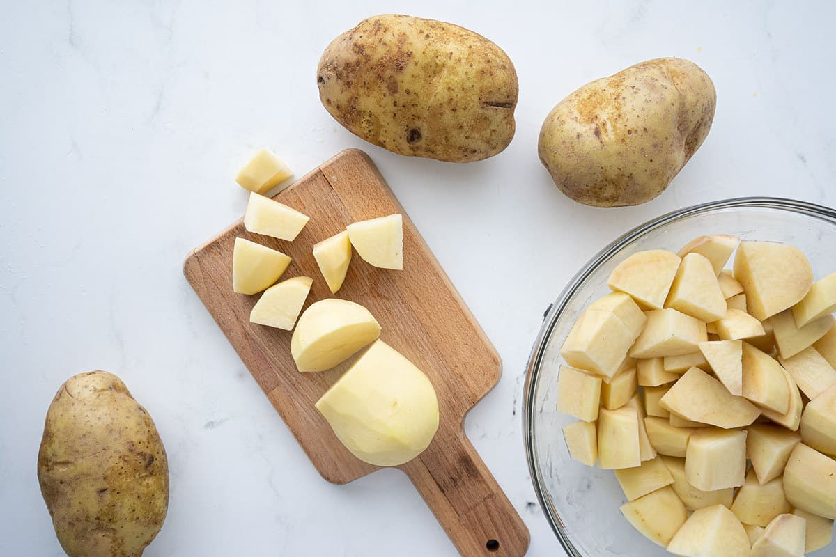 Russet potatoes on a cutting board