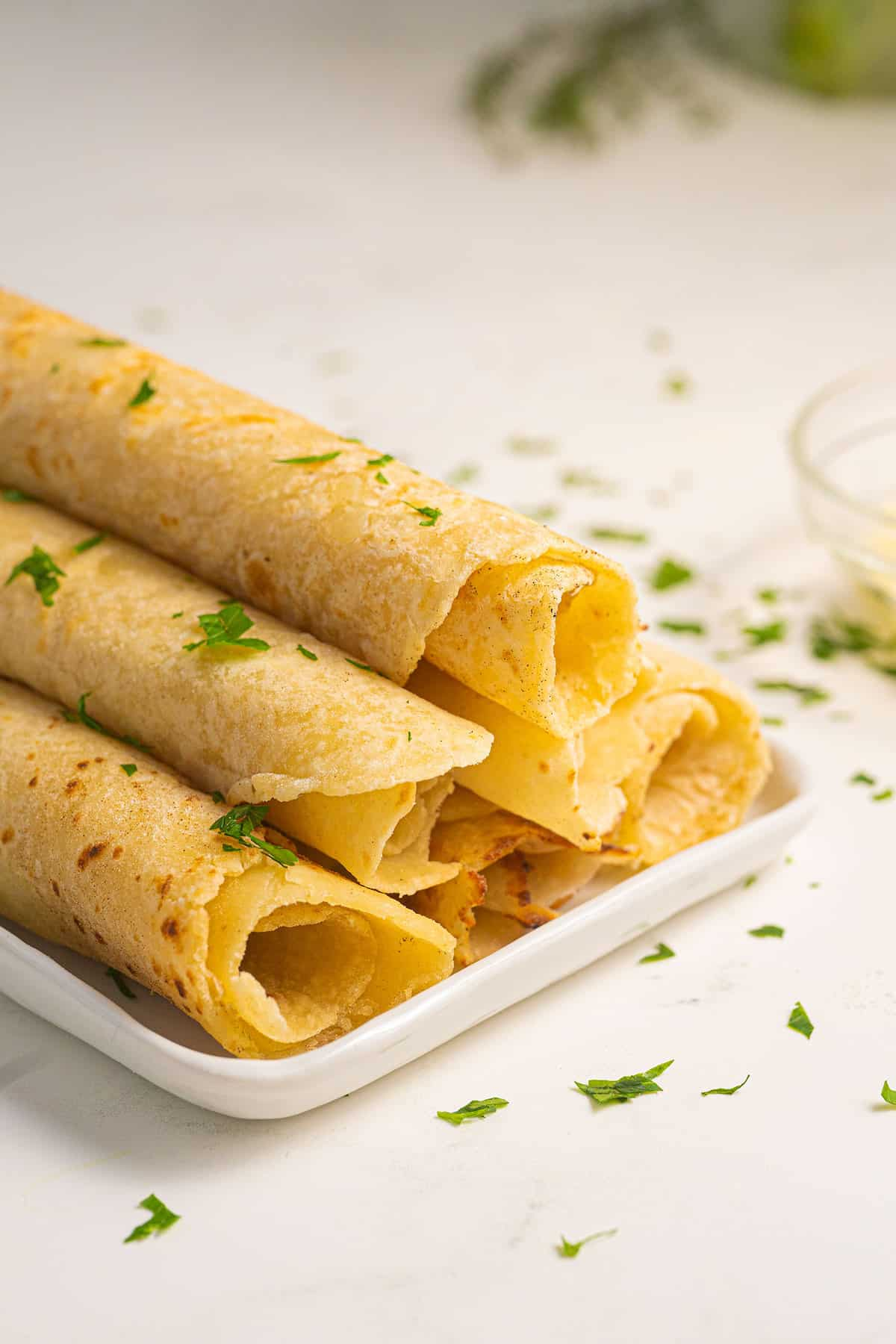 Potato Lefse rolled up on a plate