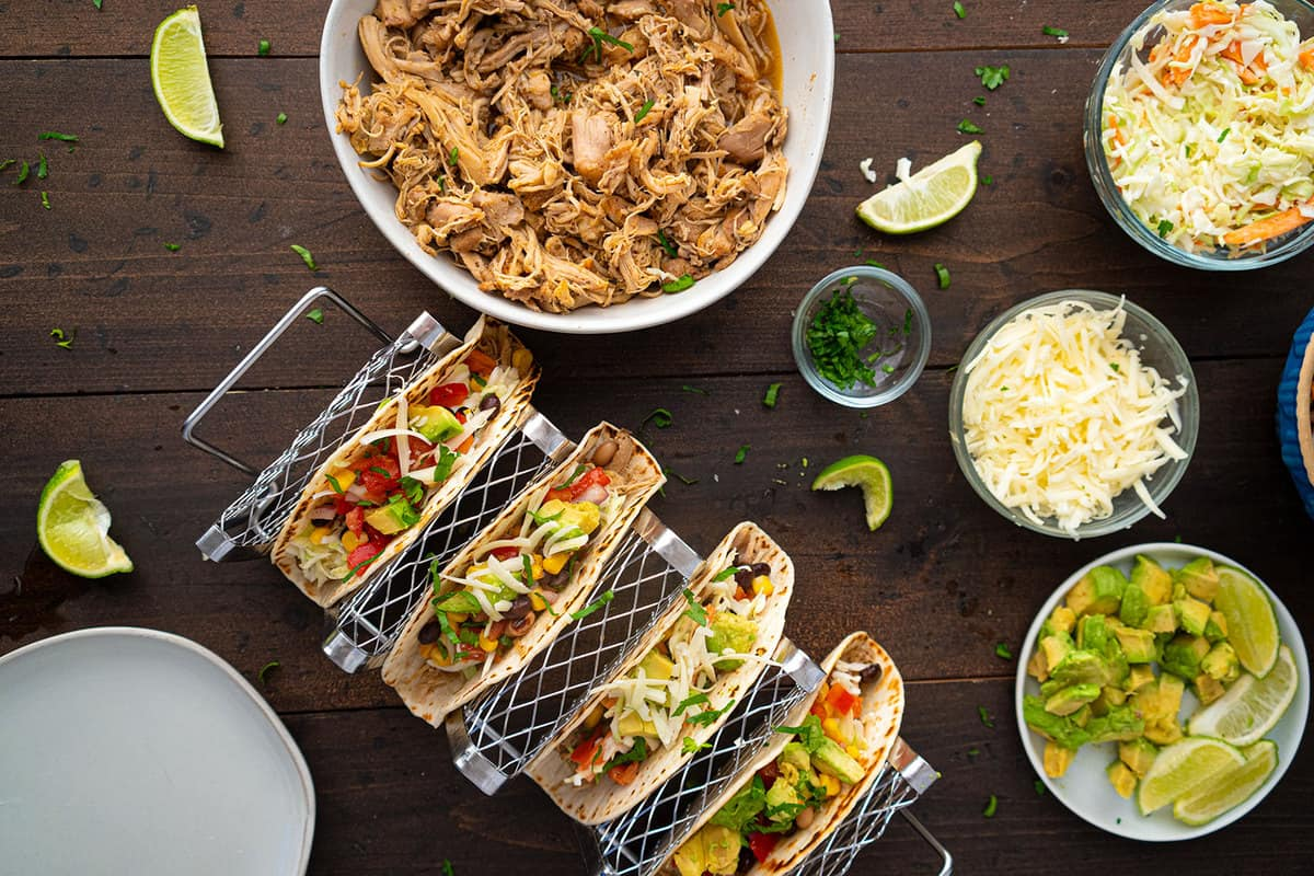 All the ingredients of making shredded chicken tacos