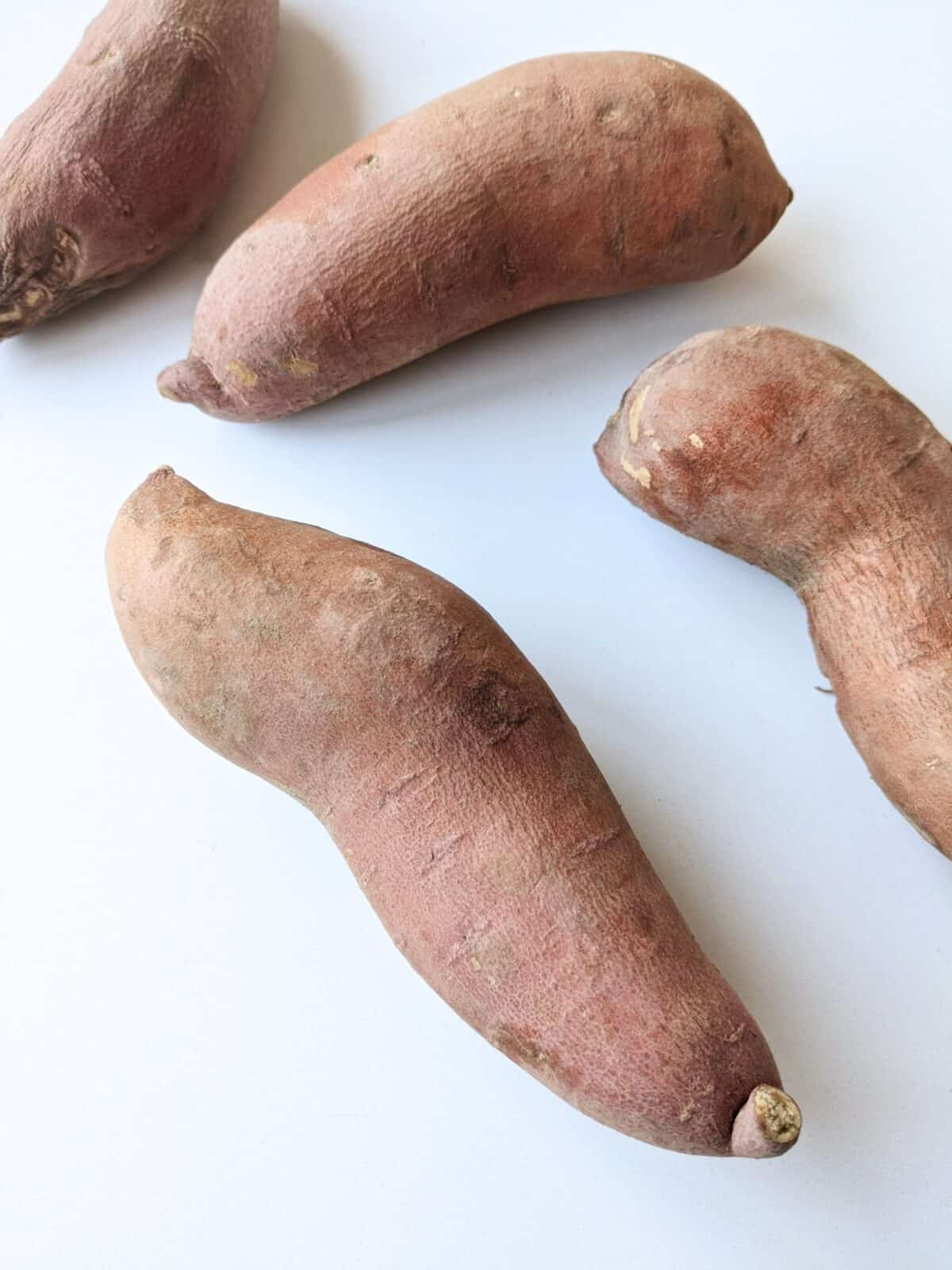 Sweet Potatoes on a white background