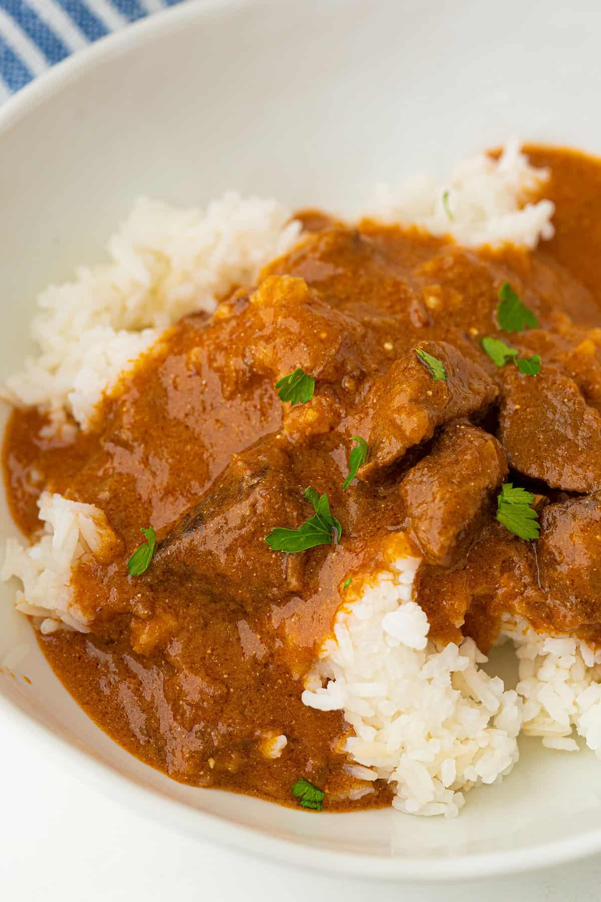 Hungarian Goulash on white rice in a bowl