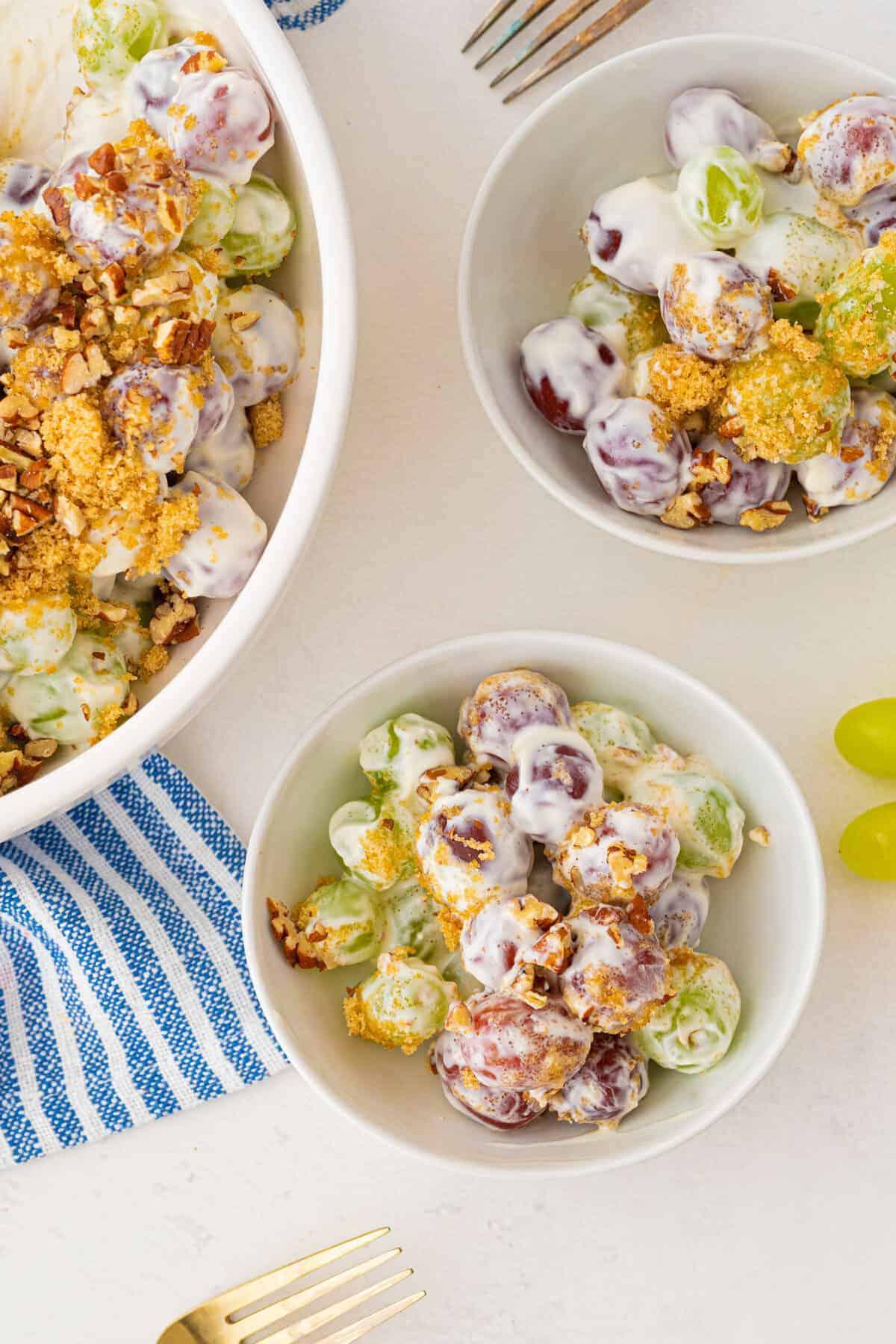 grape salad in white bowls