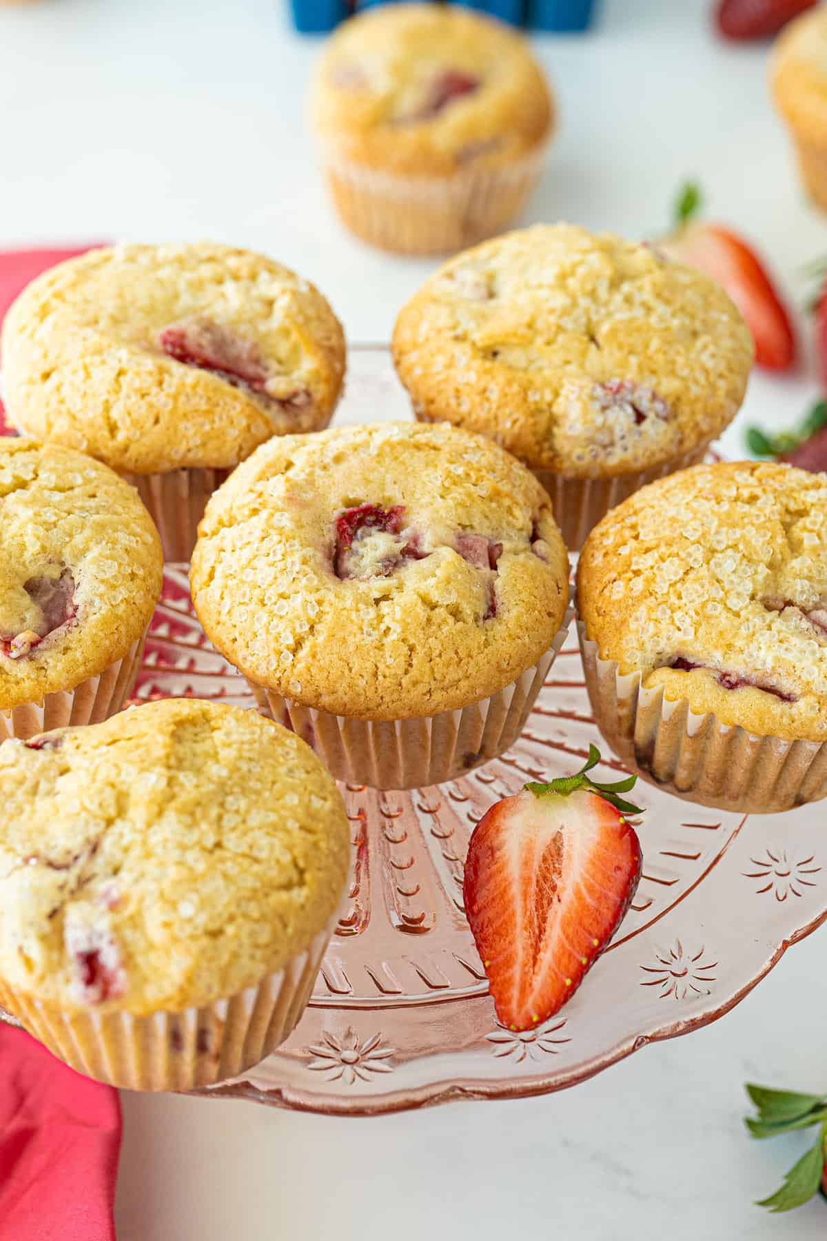 strawberry muffins on a pink platter
