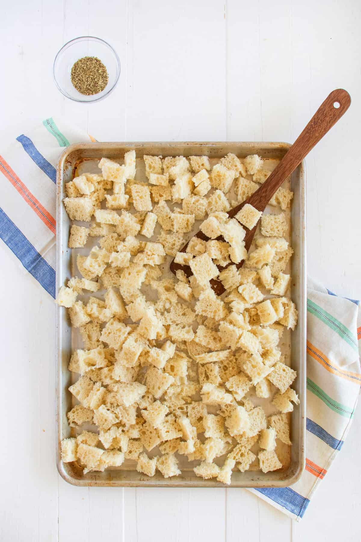 bread cubes on a baking tray