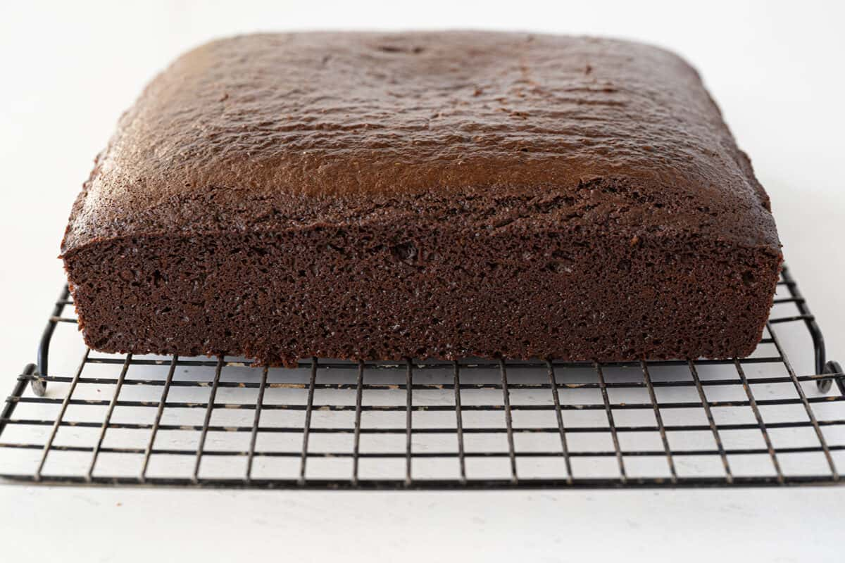 chocolate cake cooling on a wire rack