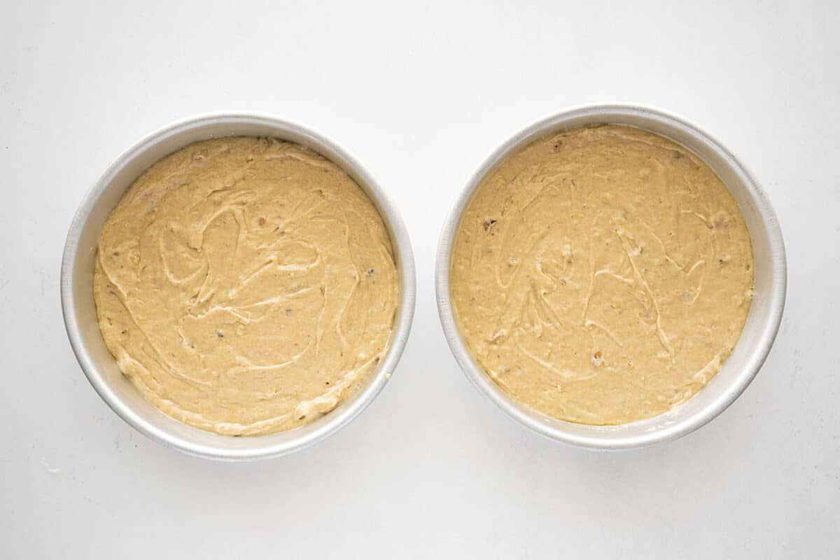 banana cake batter divided between two pans
