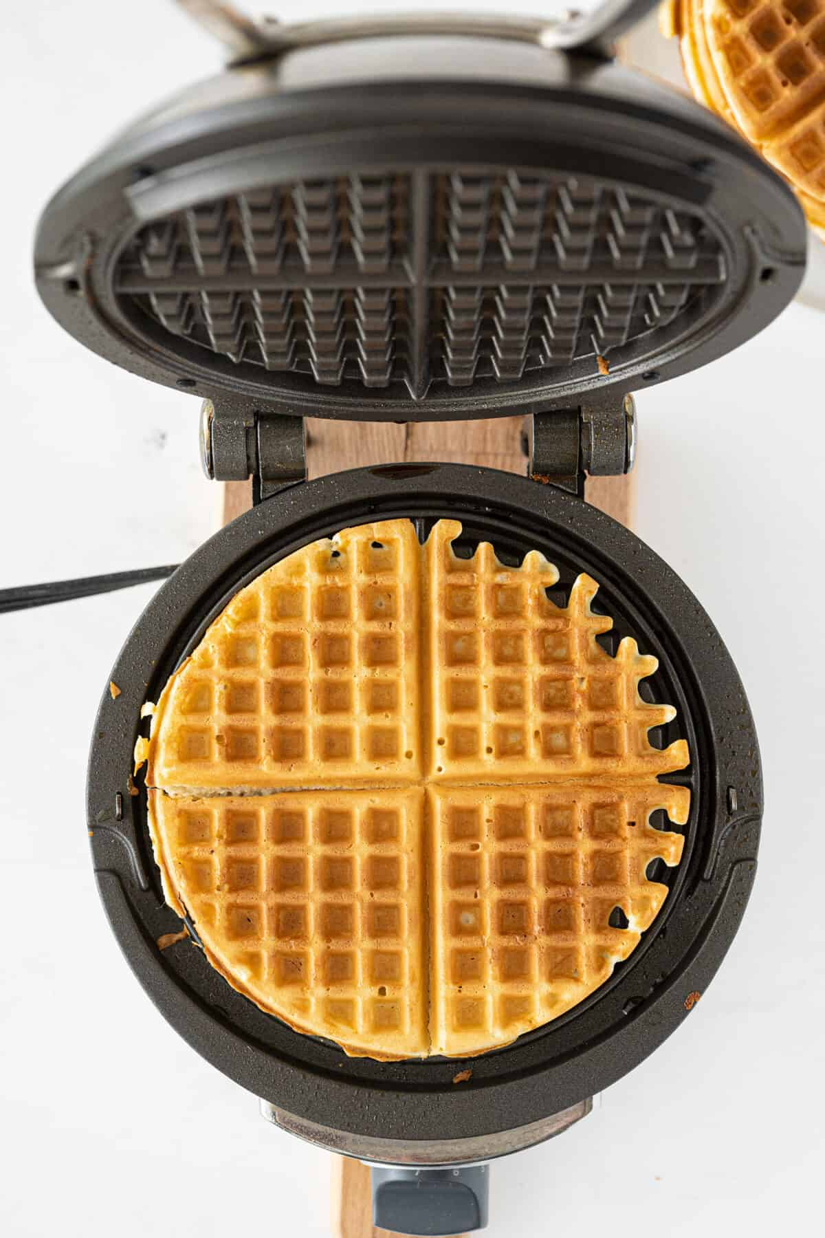 bisquick waffles being prepared in a waffle maker