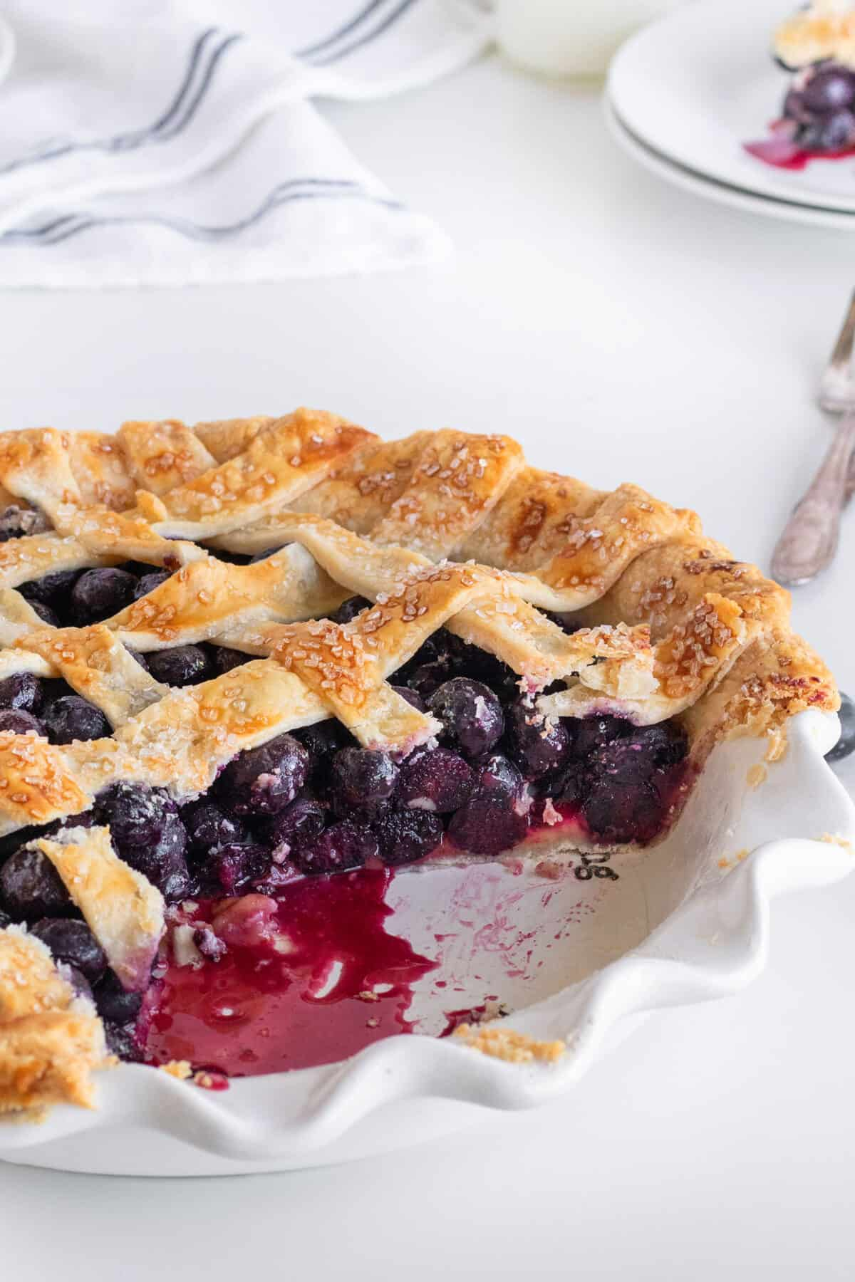 slice of blueberry pie in a pie plate