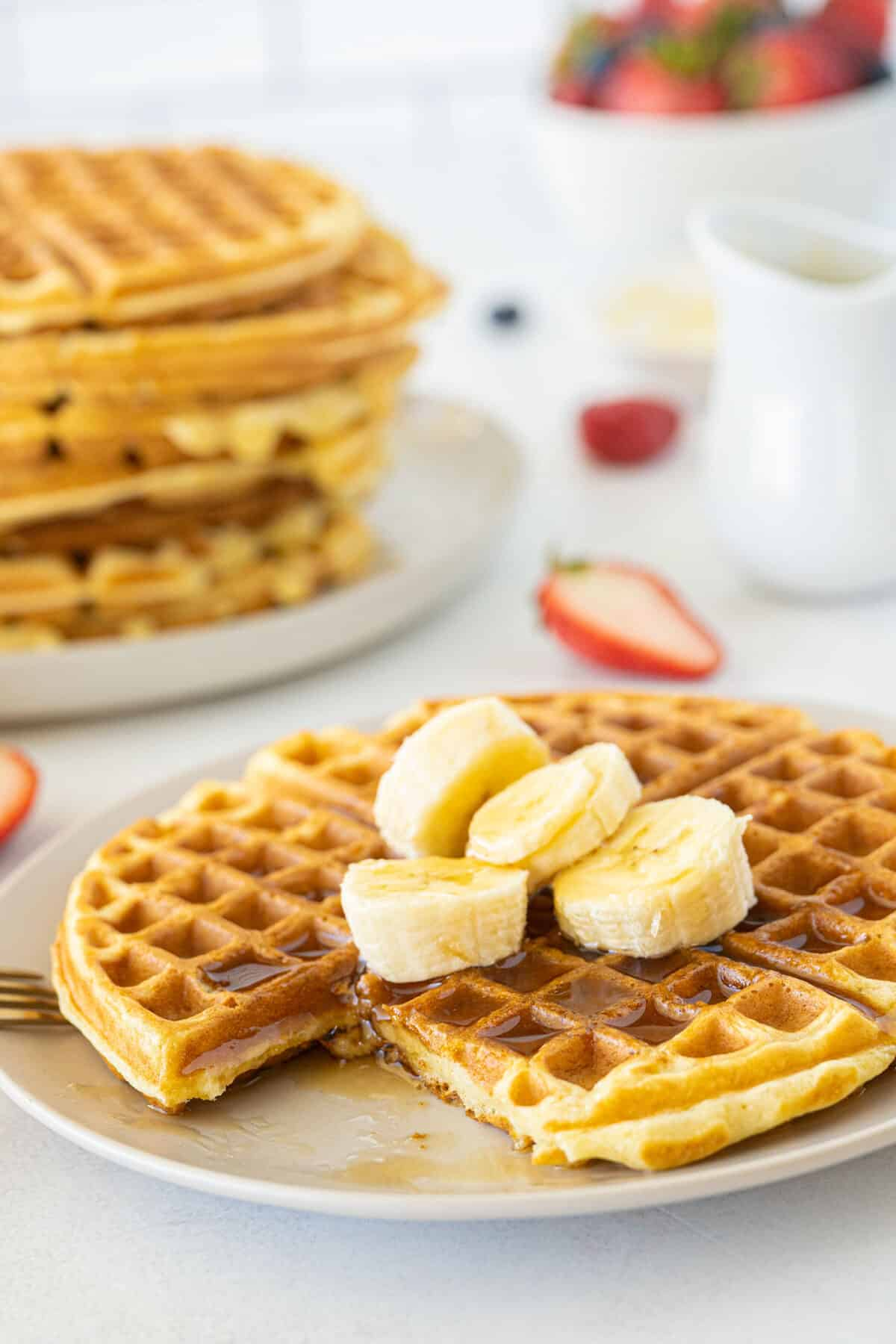 sliced buttermilk waffles with bananas and syrup on top