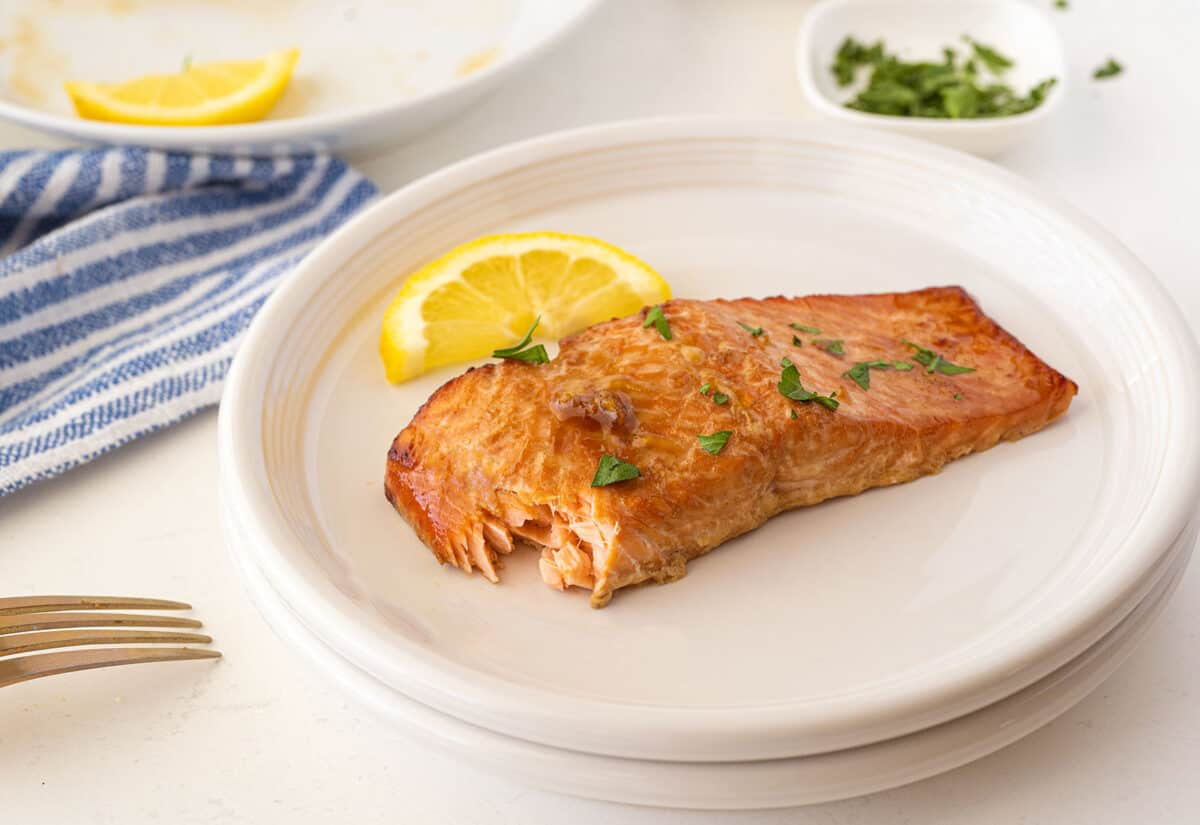 cooked salmon on a white plate