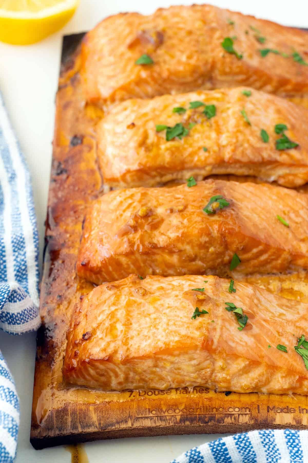 cooked salmon on a cedar board