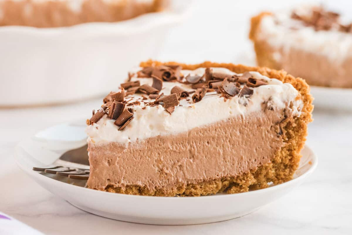 a large slice of chocolate mousse pie on a white plate