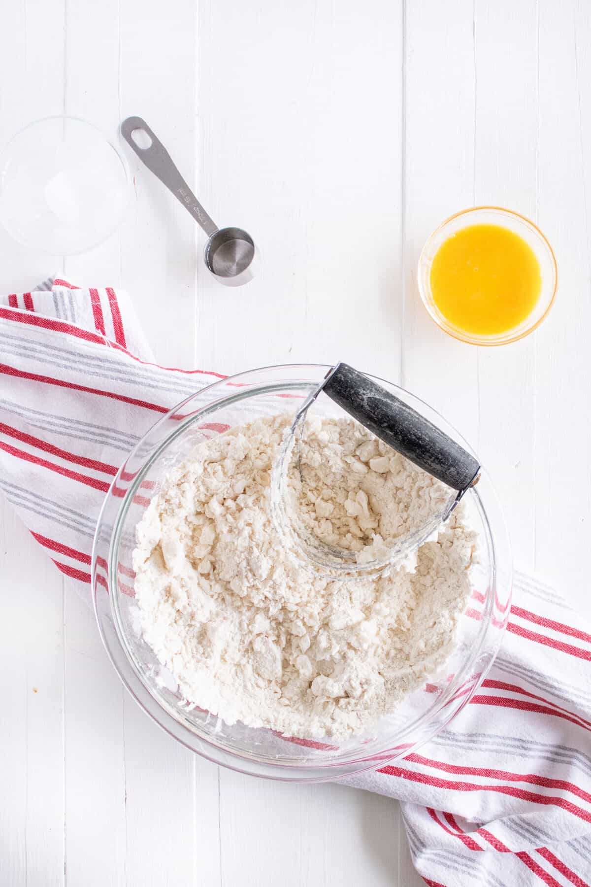 cutting the lard into the flour with a pastry blender