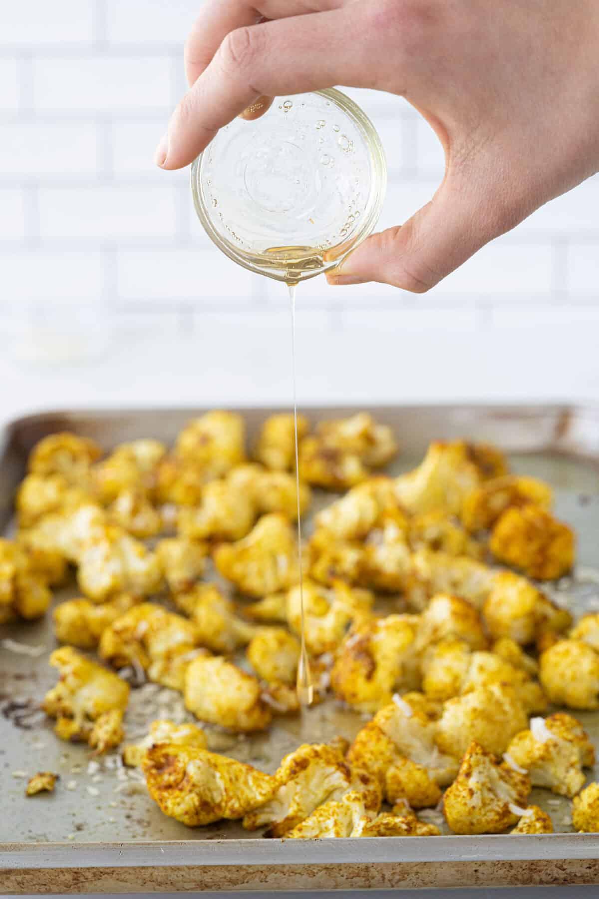 drizzling honey onto roasted cauliflower