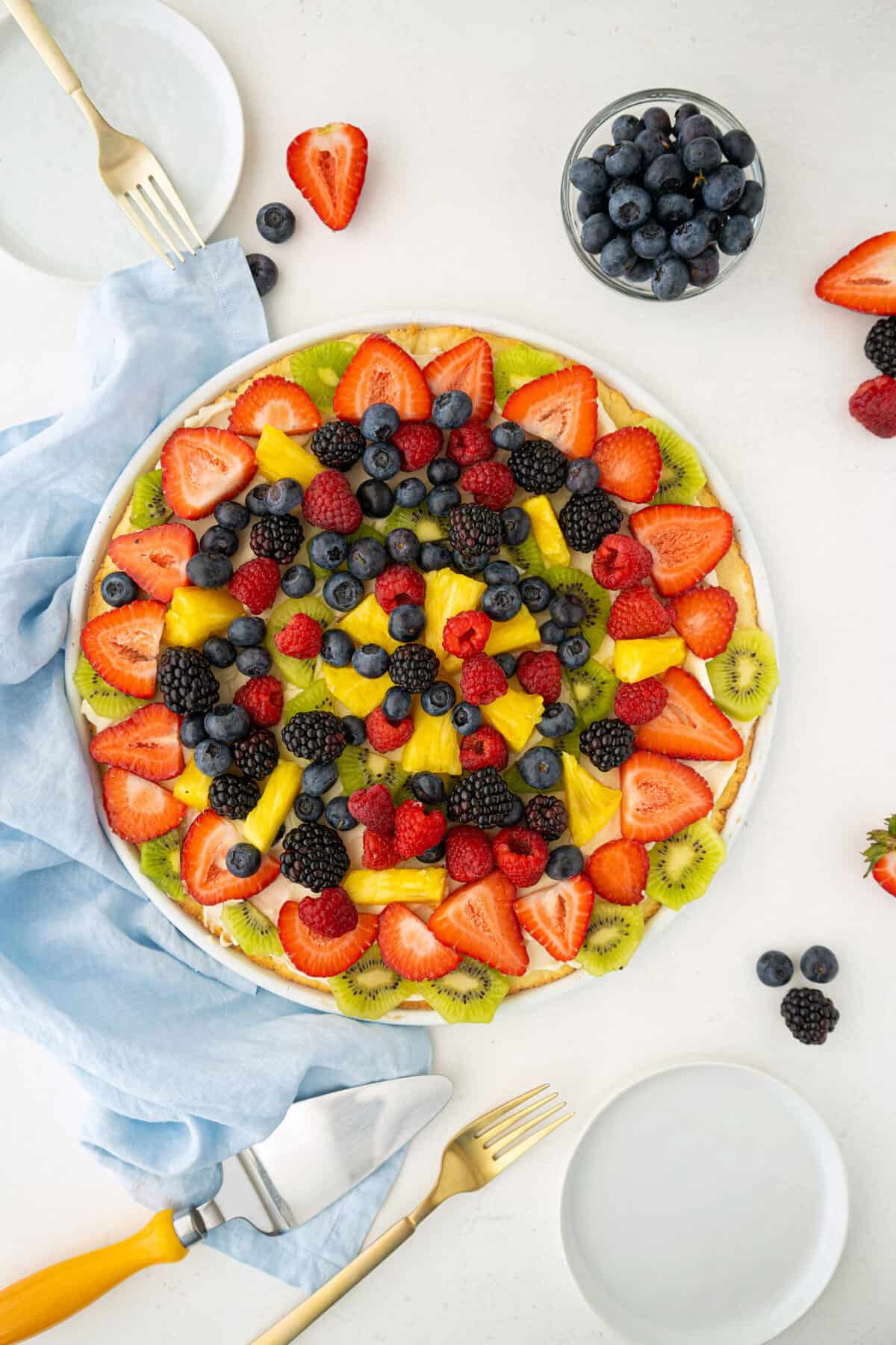 top down shot of a complete fruit pizza