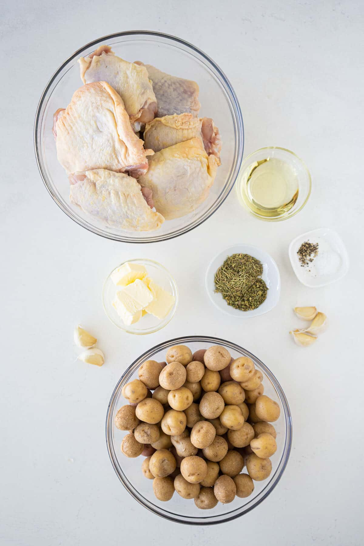 Chicken and Potatoes ingredients on a white counter