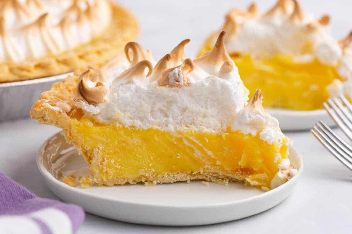 lemon meringue pie on a white plate