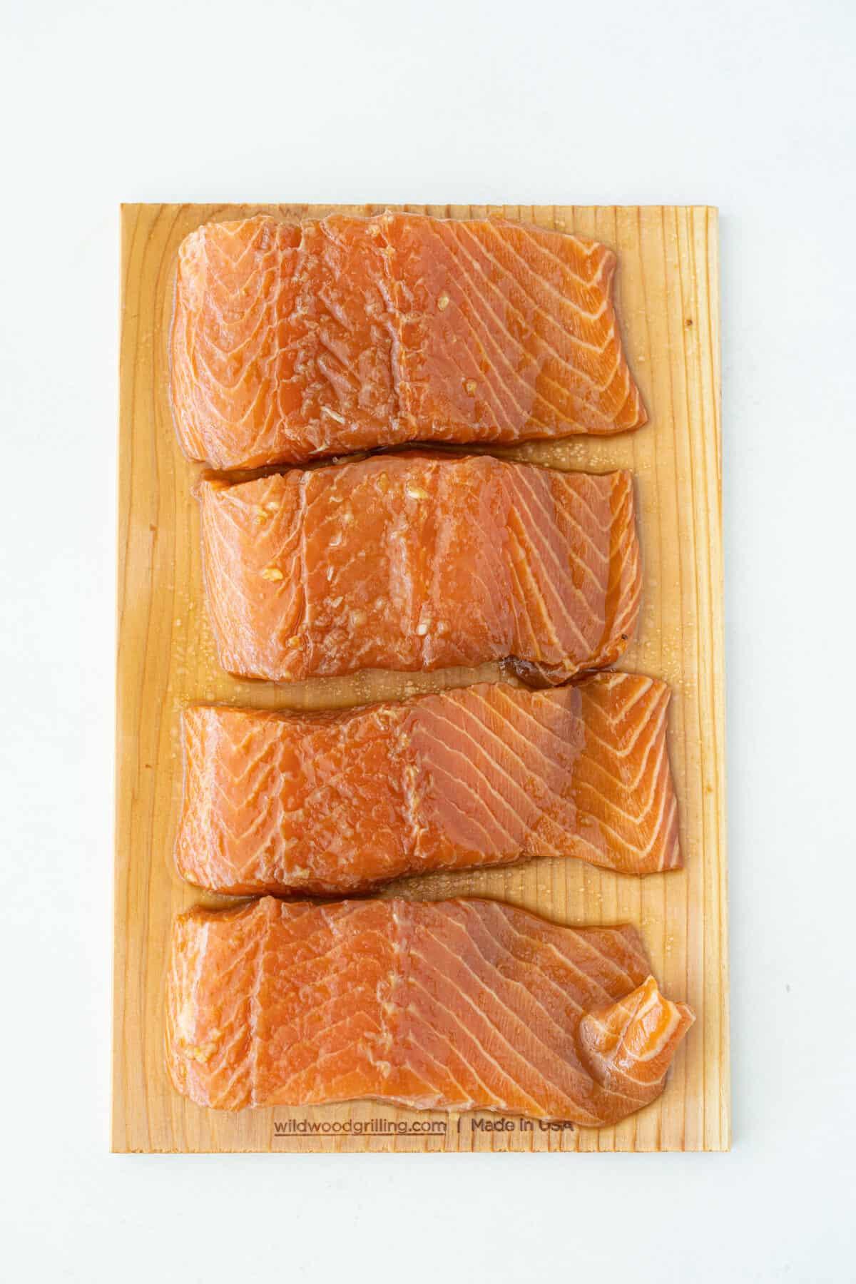 marinated raw salmon on a cedar board